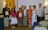 Los miembros del Comité Ejecutivo con los galardonados y otros participantes de la Asamblea Trienal.